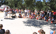 A Magic show at a Santa Maria company picnic.