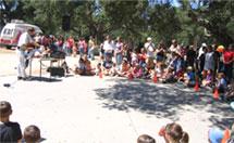 A Magic show at a Santa Maria company picnic.