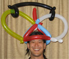 A happy balloon hat customer!